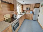 The fitted kitchen includes a fridge/freezer and dishwasher