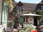 Maison de la Grandmere in spring with the wisteria in bloom lovely sunny sitting and dining w BBQ