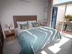 double bedroom with en suite bathroom with shower and bath