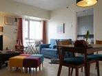 NEWLY-REFIT! OPEN PLAN living and dining area (bedroom door shown)