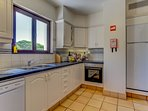 Self catering kitchen with oven, fridge/freezer, dishwasher, washing machine and blender