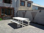 Private patio area with furniture & gas BBQ