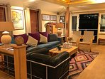 Tower Bridge Houseboat: The living room at night.