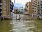 St Saviours Dock and footbridge to Butlers Wharf, seen from The Harpy at high tide.