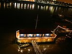 Tower Bridge Houseboat: The Harpy from above at night.