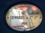The original (and for this photo at least, highly polished) ship's makers plate; 1904.