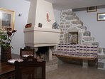 This is upper level living room. All the furniture of the tower are antiques and family objects.