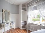 Upstairs twin double room with vanity mirror, dresser, hanging space and shelves