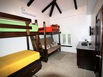 Bunk room (sleeps 6) with TV, ceiling fan and AC