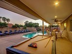 Huge covered deck with pool table, TV, Dining table and Foosball.