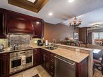 Kitchen w Full Size Stainless Steel Appliances & Granite Counters