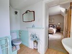 The attractive blue and white en suite features a cast iron fireplace!