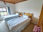 Comfortable twin bedroom, well-furnished in pine