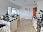 The smart fitted kitchen includes an Aga and is very well-equipped