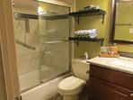 New renovated bathrorom, new toilet, bathtub, tiling, grab bars, and vanity top