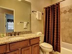 Guest bathroom comes with bath towels and hotel sized amenities.