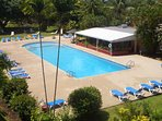 Our shared swimming pool and bar restaurant, sun loungers, table and chairs