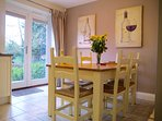 Painted oak dining table in dining area of the kitchen.