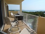 Oceanfront balcony with 2 chaise lounge chairs and table for dining for 2 or 3