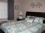 Front Queen Bedroom, beautiful linens, new curtains, TV, ceiling fan, extra AC unit