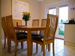 Dining area in kitchen with French doors leading to front terrace and private parking.