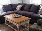 Large wrap around sofa in den