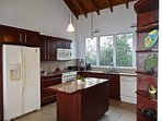 Fully equipped kitchen with cooking island in Main villa