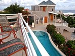 View of the pool and guest villa from the balcony of the master bedroom.