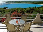Watch the clear blue sea and the crashing waves from the patio of the Guest villa