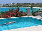 Swim laps surouded by bougainvillas and Sandy Hill beach