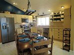 The kitchen has plenty of room for cooking and seats 6 in the dining area.