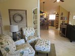 The living room has two seating areas and opens into the kitchen/dining room.