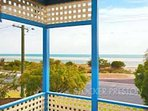 Front balcony looks across garden onto  Geograph bay, a safe and sheltered swiming beach.