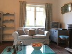 The comfortable lounge with views of the garden. UK and French digital TV with HIFI, WIFI