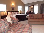 Upstairs Master Bedroom Suite with comfortable King bed, sofa and captain's chair to snuggle up in.