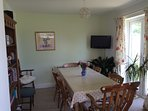 Dining room with french doors on to the garden.