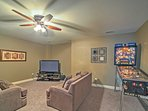 Play a fun game of pinball in the family room.