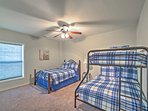 This bedroom offers full-sized bunk beds and a twin bed, perfect for a kids' room.