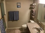 Bathroom with shower and granite counter.
