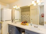 Lower queen bedroom bathroom with shower and tub