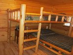 Bedroom with 2 twin bunk beds and small dresser.