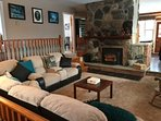 Upstairs Living Room has a cozy Fireplace with wood and a sectional with 4 lazyboys.