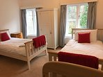 Bedroom Two at Riversdale Lodge - two single beds with Cot and ensuite. Views over the River Wye.