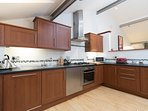 kitchen with electric oven, gas hob, washer/dryer, fridge/freezer etc
