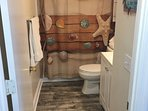 Hall bathroom, shower, new higher toilet, new vanity sink, with LED faucet new floor linens, storage