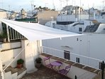 The roof terrace has a view on the white houses of Ostuni...