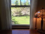 The view from the desk—fruit trees and lilacs
