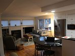 Look toward casual living area with flat screen TV and Porch access