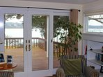 A look out to porch / deck from casual living area