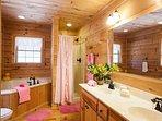 master bath w/ bath and shower
